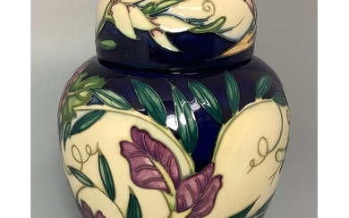 A Moorcroft pottery vase in the 'Tempest' pattern after Phil...