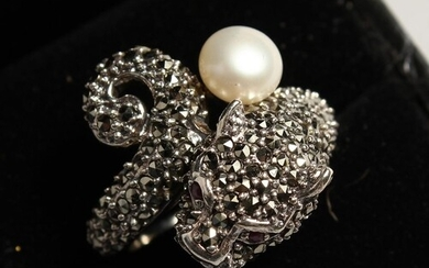 A SILVER AND MARCASITE PANTHER AND PEARL RING