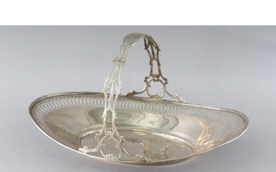 A STERLING SILVER PIERCED OVAL CAKE BASKET with handle. Weig...