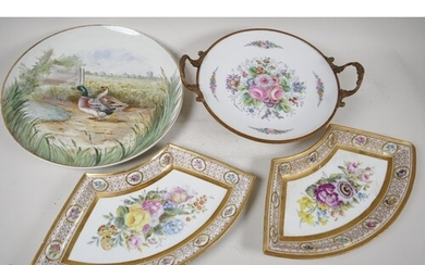 A continental porcelain and ormolu tazza painted with flower...