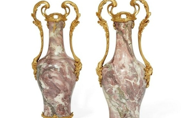 A pair of Louis XV style bronze & marble vases