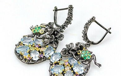 A pair of ear pendants each set with numerous topaz, sapphires, onyx, amethyst and opales, mounted in black rhodium plated and gilded sterling silver. L. 4.6 cm – Bruun Rasmussen Auctioneers of Fine Art