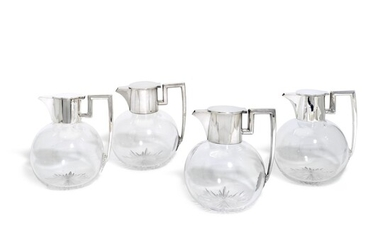 A set of five Victorian and Edwardian silver-mounted claret jugs, John Grinsell & Sons, London, 1892 and 1903