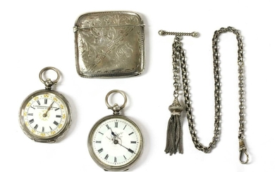 A silver key wound open-faced fob watch