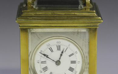 An early 20th century French brass cased carriage clock with eight day movement striking hours and h