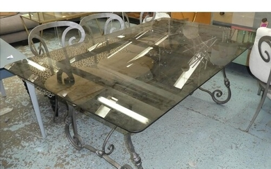 DINING TABLE, contemporary worked metal design with smoked g...