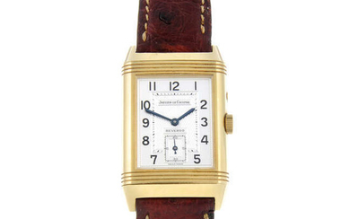 JAEGER-LECOULTRE - a gentleman's 18ct yellow gold Reverso Night & Day wrist watch.