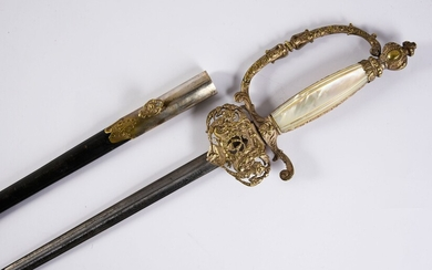 PREFET HENRI GOULLEY'S APPARAT Sword.Silver plated metal frame, with carved decoration of floral motifs, arabesques and leafy garlands. Fuse in mother-of-pearl plates. Triangular steel blade engraved with foliage on its first third, preserved with...