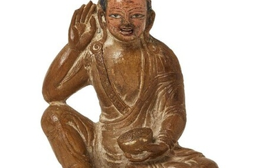 Property of a Gentleman (lots 36-85) A Tibetan carved hardstone figure of a monk, 18th/19th century, seated on a lotus base with his right hand held to his ear and his left clutching an alms bowl in his lap, his hair and features finely detailed...