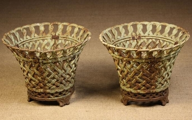 Two Large Cast Iron Garden Basket Planters. The flared...