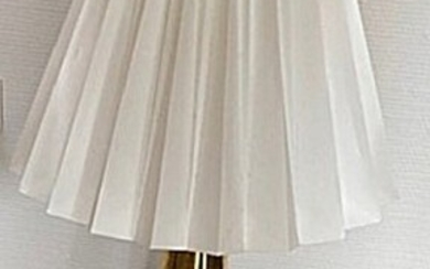 NOT SOLD. Unknown designer: A brass table lamp with white pleated shade. H. 50 cm....