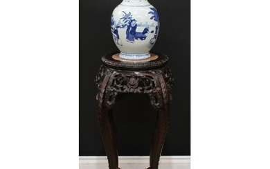 A Chinese hardwood vase or jardiniere stand, circular top wi...
