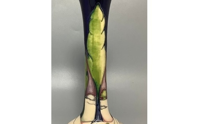 A Moorcroft Pottery vase of Persian bottle form, decorated i...