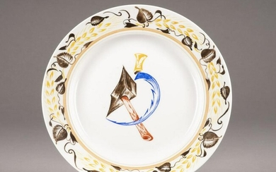 A PORCELAIN PLATE WITH HAMMER AND SICKLE