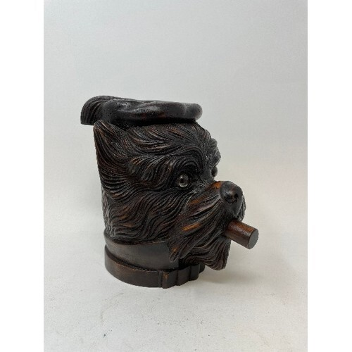 A carved wood tobacco box and cover, in the form of a dog, 1...