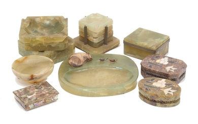 A group of onyx objects, mid 20th century, to include an ash-tray mounted with a model of a cat and two mice, 19cm wide, two large squared ash-trays, a 'stacked' set of ashtrays, 8cm high inclusive, and other similar wares (9)