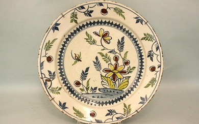 A mid 18th century Bristol delft charger decorated with
