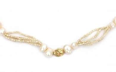 A multiple strand pearl necklace with gold spacers and an 18 carat gold clasp. Composed of five strands seed pearls and cultured baroque shaped pearls, combined with five flat shaped gold spacer beads to an 18 carat gold clasp. Gross weight: 20.6 g.