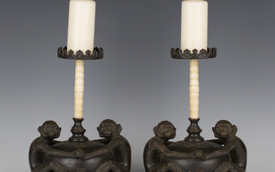 A pair of 20th century South-east Asian brown patinated cast bronze pricket candlesticks, each folia
