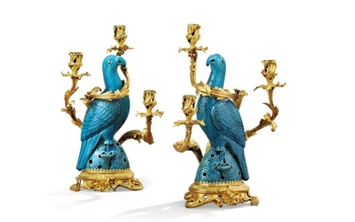 A pair of gilt-bronze and Chinese porcelain candelabra by Henry Dasson, Paris, 1889, the porcelain mid-18th century