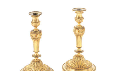 A pair of late 19th century French gilt bronze candlesticks in the Louis XVI style