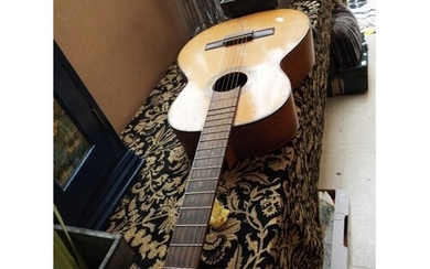 An early guitar with a rosewood back and ribs and inlay to t...