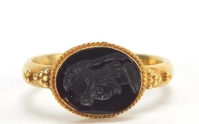 Antique unmarked gold intaglio seal ring carved with a gladi...