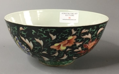 Chinese porcelain bowl hand painted in the famille noirpalette...