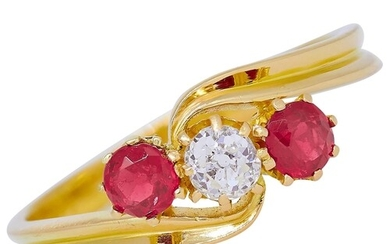 RUBY AND DIAMOND 3-STONE TWIST RING, in 18 ct. gold. Set wit...