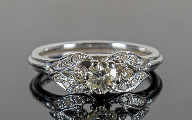 Ring with diamonds.
