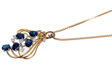 Sapphire and diamond cluster pendant with five oval mixed cut blue sapphires and six brilliant cut diamonds in asymmetric scroll setting on 18ct yellow gold chain.