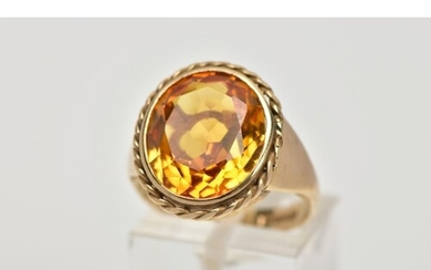 A 9CT GOLD SYNTHETIC ORANGE SAPPHIRE DRESS RING, designed wi...