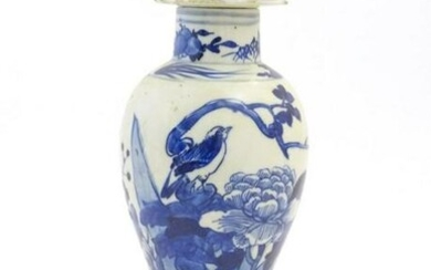 A Chinese blue and white vase and cover with floral