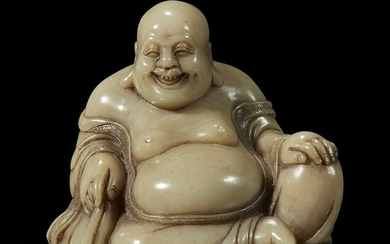 A Chinese carved soapstone figure of a seated Budai 寿山石雕布袋和尚
