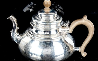A George V silver squat teapot, in Queen Anne style, with sc...