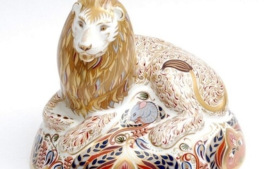 A boxed Royal Crown Derby paperweight Lion, gold stopper.