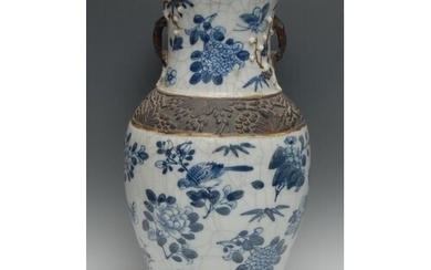 A large Chinese ovoid vase, painted in tones of underglaze b...