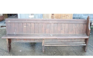 """A late Victorian stained pine single-ended pew, 86"""" long"""