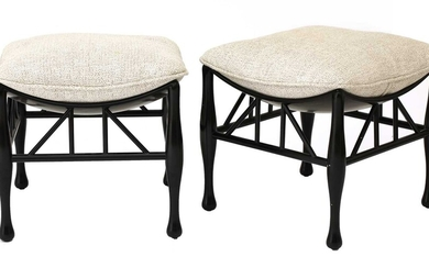 A pair of ebonised Thebes-style stools