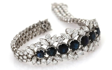A sapphire and diamond bracelet set with numerous sapphires flanked by numerous diamonds weighing a total of app. 13.0 ct., mounted in 18k white gold. – Bruun Rasmussen Auctioneers of Fine Art