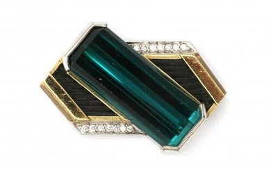 An 18 carat gold two tone tourmaline and diamond pendant. Featuring a dark green emerald cut tourmaline surrounded with fourteen brilliant cut diamonds, ca. 0.20 ct. in total. Gross weight: 15.8 g.