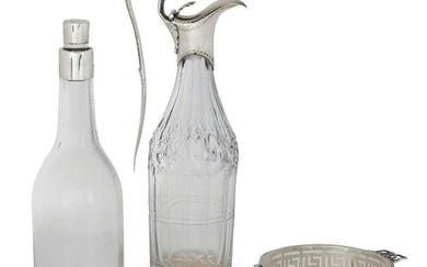 An 18th century silver mounted glass cruet bottle by Hester Bateman, date mark rubbed, designed with elongated handle and hinged lid with stylised shell thumbpiece, the bright-cut engraved collar to cut glass body, 18.3cm high, together with a...