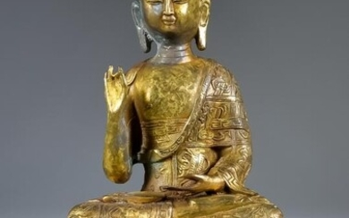 An Indo Chinese Gilt Bronze Figure of the Seated...