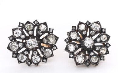 Diamond cluster ring set centrally with a diamond within a b...