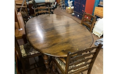 Ercol extending dining table and 4 chairs (2 carvers).