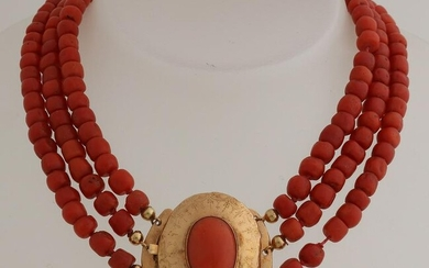Necklace of large red corals attached to a yellow gold