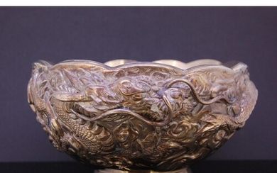CHINESE SILVER DRAGON BOWL, decorated all around with a drag...