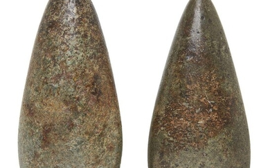 Two Neolithic polished stone axe heads, 15cm. and 13.2cm. long (2) Provenance: Private Collection Oliver Hoare (1945-2018)