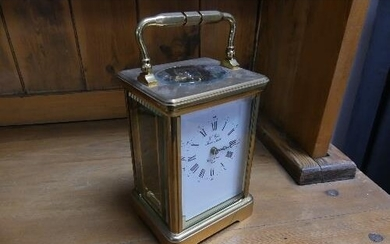A 20th century French gilt brass Carriage Clock, signed L'Ep...