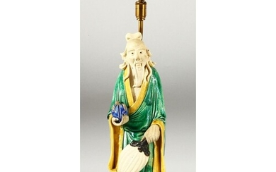 A CHINESE FAMILLE VERTE GLAZED POTTERY FIGURAL LAMP, overall...